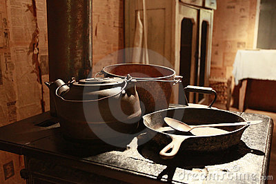 Old stove with pots and pans