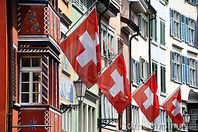 Old street in Zurich decorated with flags