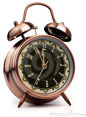 Old Style Alarm Clock On White