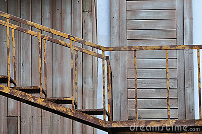 Old style ladder and wooden door