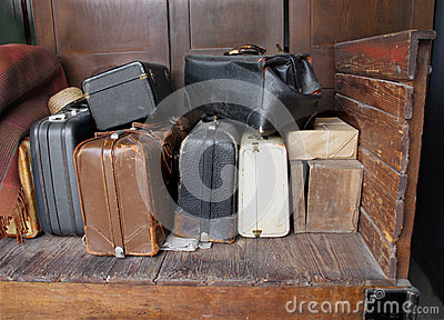 Old suitcases on an old wooden cart