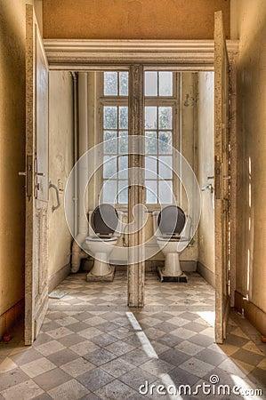 Free Old Symmetrical Toilets Royalty Free Stock Photos - 119979008