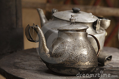 Old teapot and kettle in a kyrgyz yurt kitchen