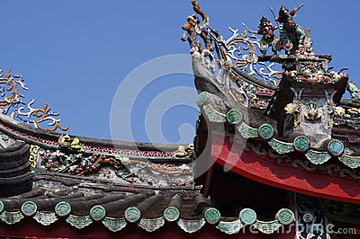 Mini-Sculpture of Chinese mythology on top of a te