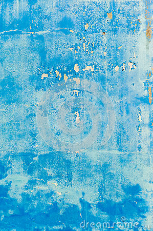 Old textured blue wall with stains