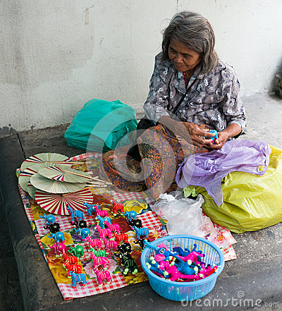 Old Thai Woman selling Toys Editorial Stock Image