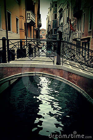 Old tiny bridge in venice, italy