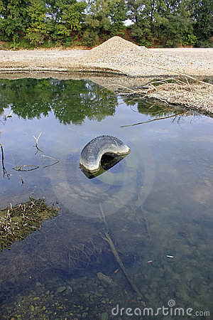 Old tire in the river