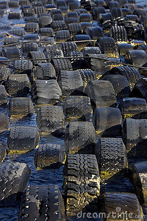 Old tires serve as breakwater.