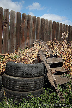 Old Tires Amp Wood Pallet Amp Fence Royalty Free Stock Photos