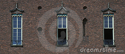Old town building wall with three window