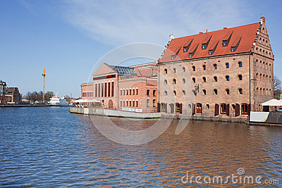 Old town houses and street cafes over Motlawa river in Gdansk, P