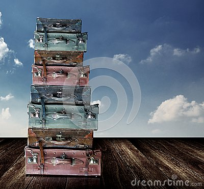 Old travel luggage with nice sky