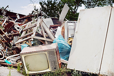 Old TV set and fridge on the dump