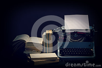 Old typewriter with opened books retro colors on the desk