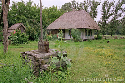 Old Ukrainian house and a well