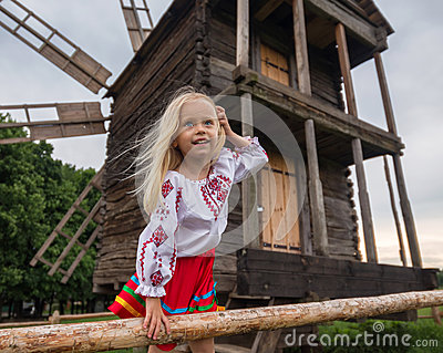 Old ukrainian mill and little girl