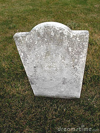 Old unmarked headstone on grass