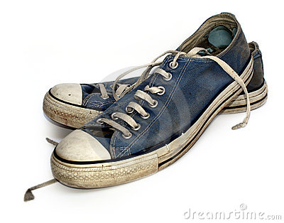 Old used and worn out sneakers or trainers