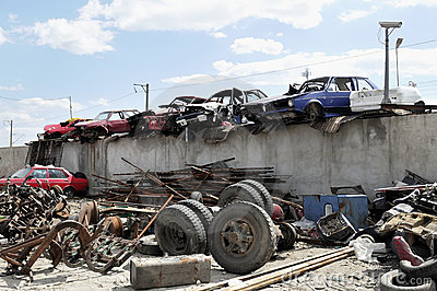 Old vehicles in an auto salvage yard