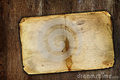 Old vintage paper on brown wooden surface