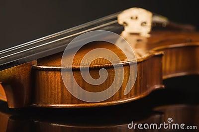 Old violin over black