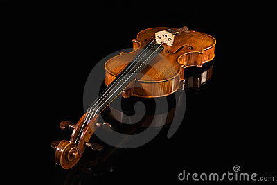 Old violin over black