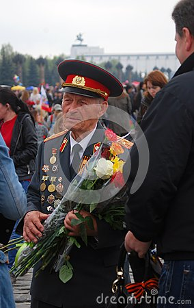 Old war veteran with flowers, Victory Day Editorial Photo