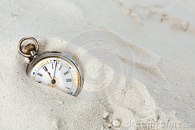 Old watch in the sand