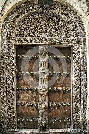 Free Old Weathered Carved Traditional Zanzibarian Door Royalty Free Stock Photos - 52589028