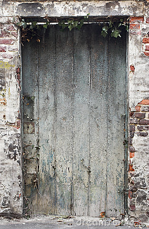 Old weathered deteriorated wooden door