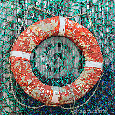 Free Old Weathered Lifebuoy On Wooden Wall Stock Photo - 27389340