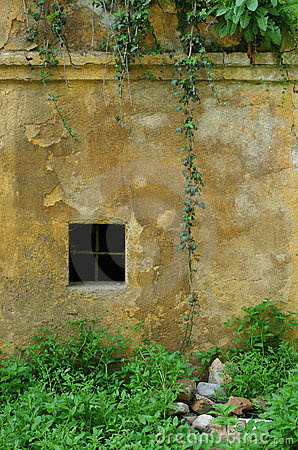 Old weathered wall with window