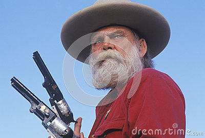Old West gunslinger drawing guns Editorial Photography