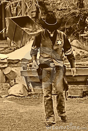 Free Old West-Marshall Walks Alone Stock Photography - 684132