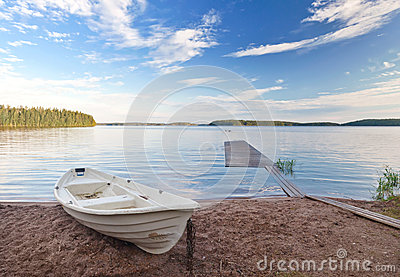 old white boat on the coast of Saimaa lake, Finla