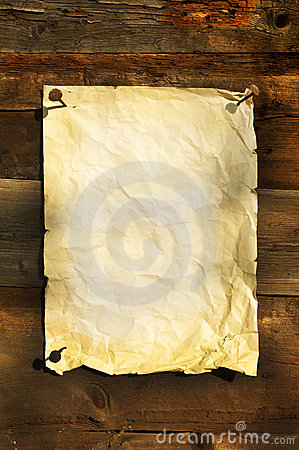Old white paper clipped on boards background