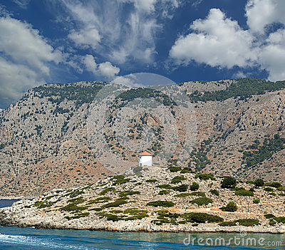 Old windmill on the shore of one of the Greek islands