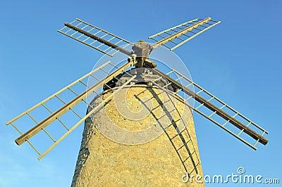 Old windmill at sunrise