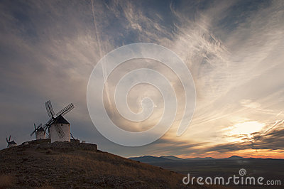 Old windmill at the sunset