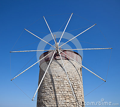 Old windmills in Mandraki harbor Rhodes Greece