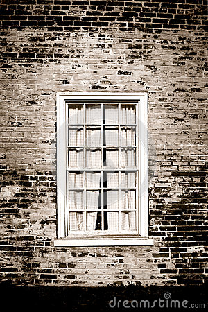 Old Window and Brick Wall on Historic Building