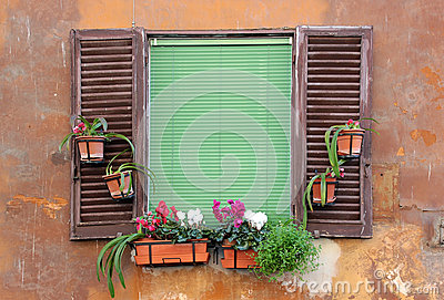 Old window with shutters in Rome, Italy