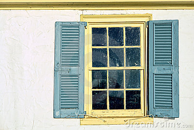 Old Window with Vintage Shutters on Historic Home