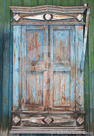 Free Old Window With Cracked Decorative Frame And Storm Shutters Clos Stock Photos - 72365053