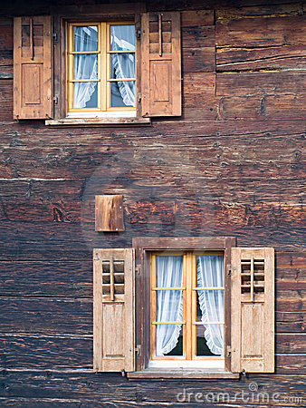 Old windows in wooden chalet