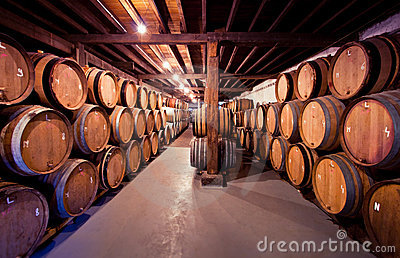 Old wine cellar with barrels in stacks
