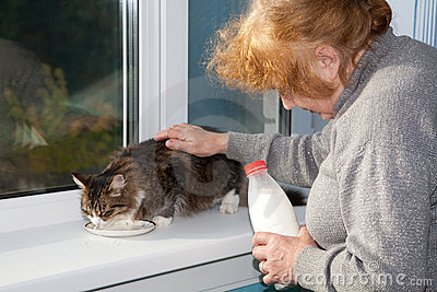 The old woman allows to have  drink  cat milk