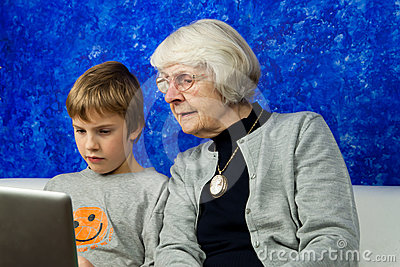 Old woman and boy looking at a laptop