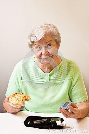 Old woman with bun and blood glucose meter